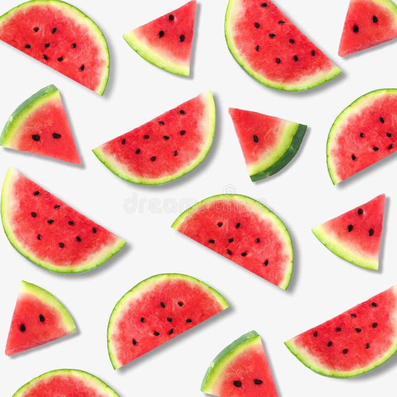 Watermelon slice summer fruit pattern on a white background. Colorful summer fruit pattern of watermelon slices on a white background stock photos