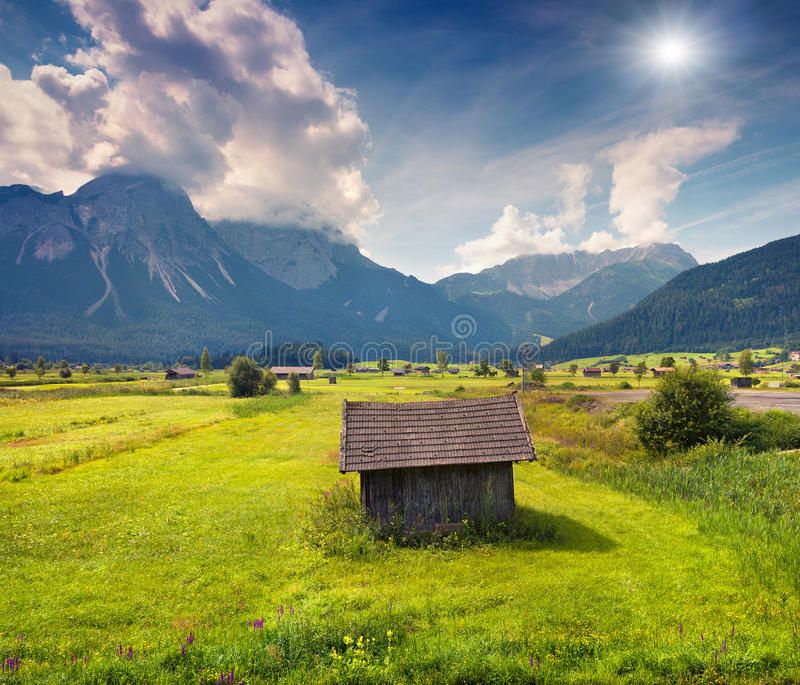 Colorful summer morning on the Golf club Zugspitze stock image