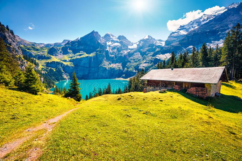 Colorful summer morning on the unique Oeschinensee Lake. Splendid outdoor scene in the Swiss Alps with Bluemlisalp mountain, Kande stock images