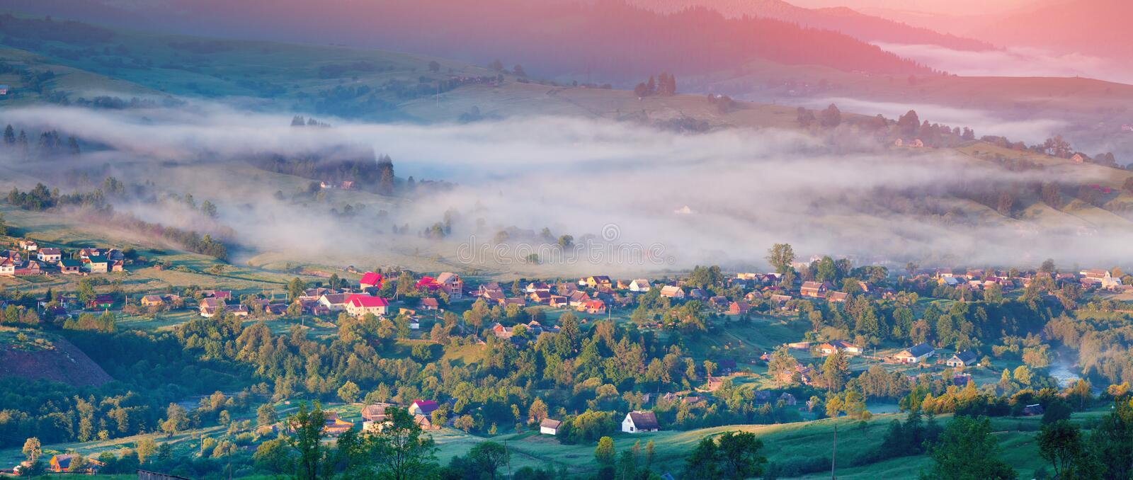 Colorful summer panorama of sunrise un mountain village royalty free stock image