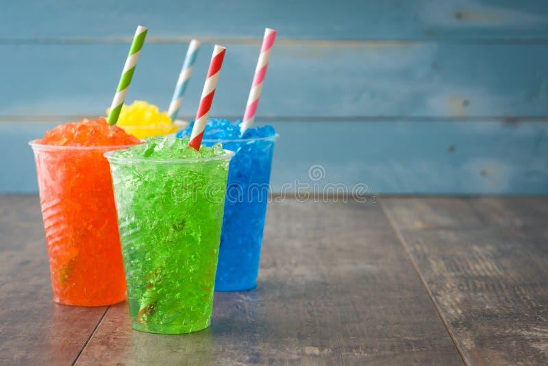 Colorful summer slushies on blue wood royalty free stock photo