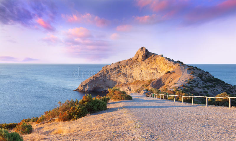 Colorful summer sunrise on the sea. Cape Kapchik, Crimea stock image