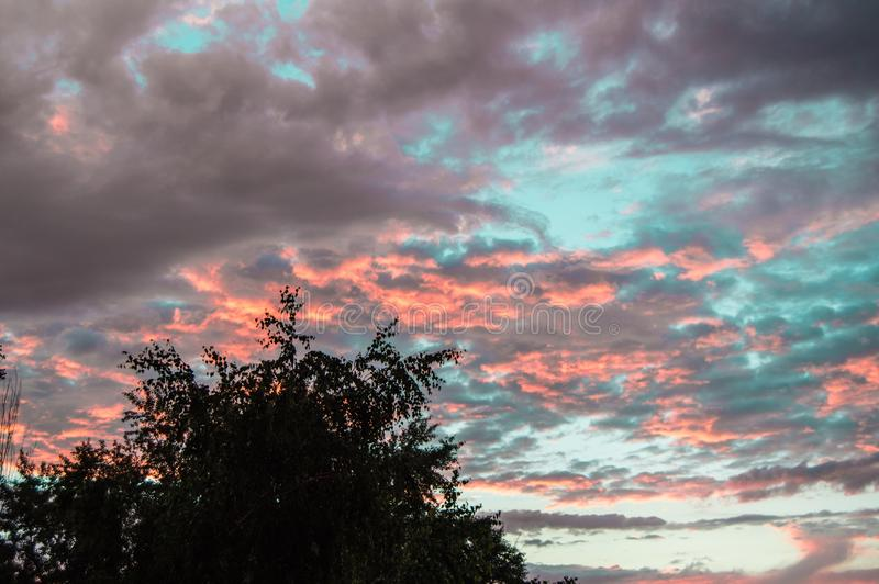 Colorful summer sunset after rain with dramatic blue and pink clouds, weather concept, seasonal specifics, copy space. Sky, dawn, dusk, light, nature stock image