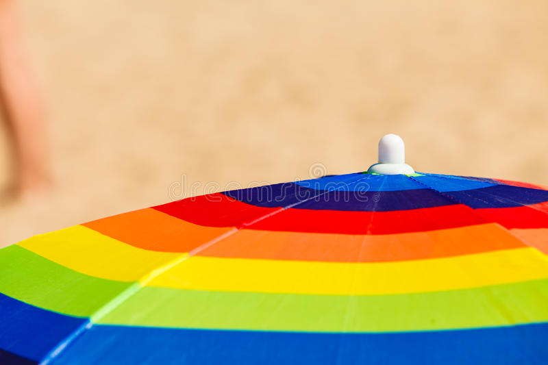 Colorful summer umbrella parasol during summertime. Beach objects and accessories concept. Colorful summer umbrella parasol during summertime weather royalty free stock images
