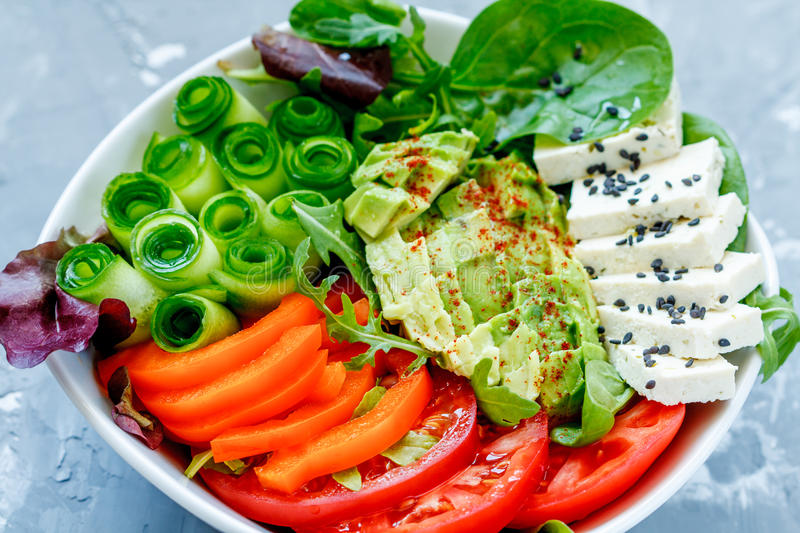 Colorful summer vegan salad with tofu and vegetables. royalty free stock images