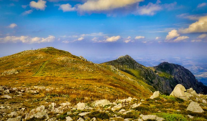 Rocky Mountain Peaks under Blue Sky with White Clouds panoramic royalty free stock photo