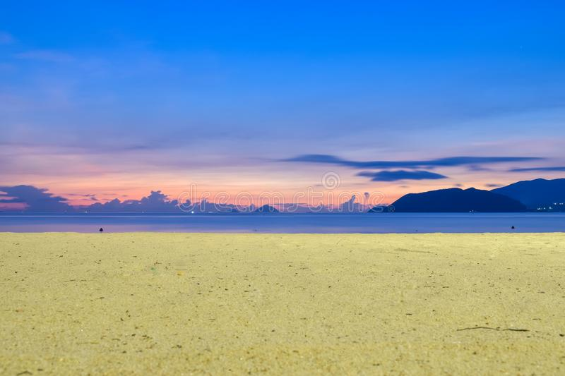 Colorful sunrise on the beach with yellow sand royalty free stock photos