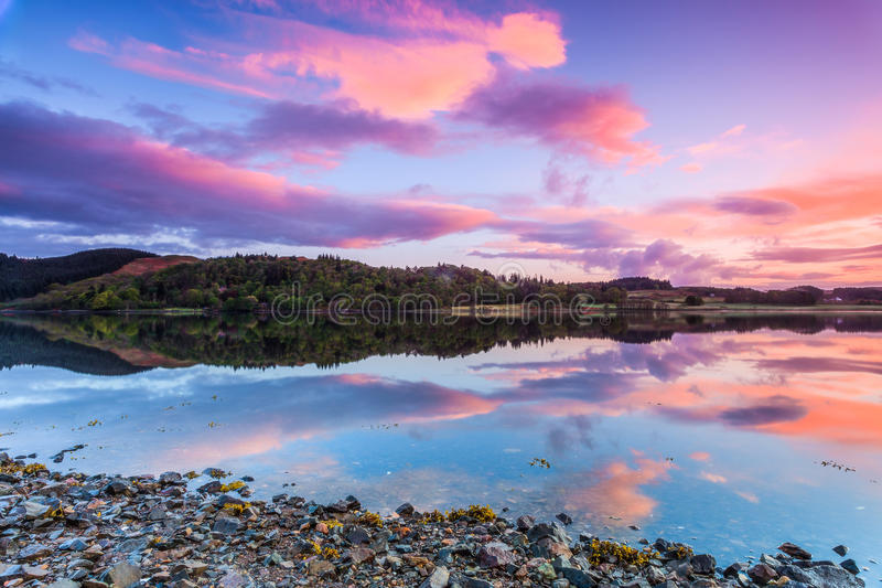 Colorful sunrise at a lake stock images