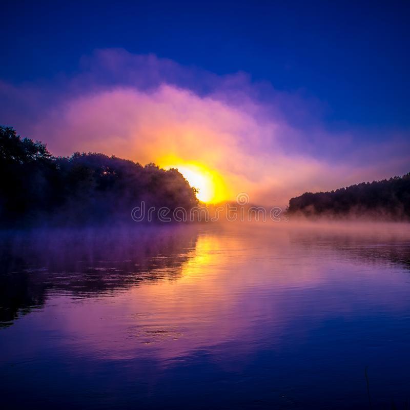 Colorful sunrise near water royalty free stock photo