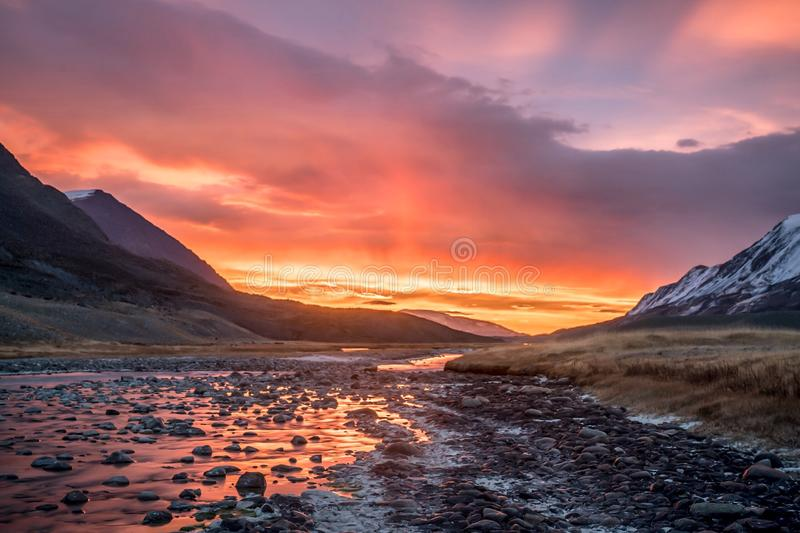 Colorful sunrise over mountains and river royalty free stock photography