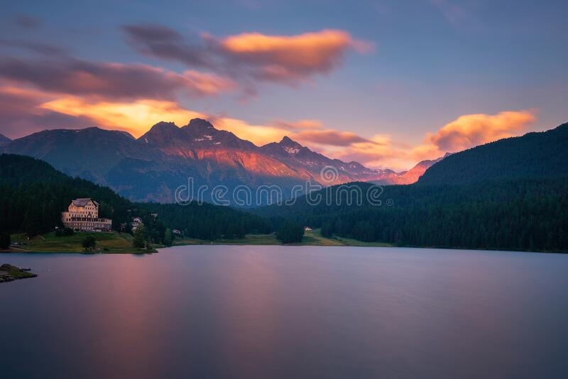 Sunset above lake St. Moritzersee with Swiss Alps and a mountain hotel. Colorful sunset above lake St. Moritzersee with Swiss Alps and a mountain hotel and stock photography