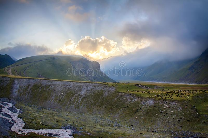 Colorful sunset in beautiful and calm moutain valley stock photography
