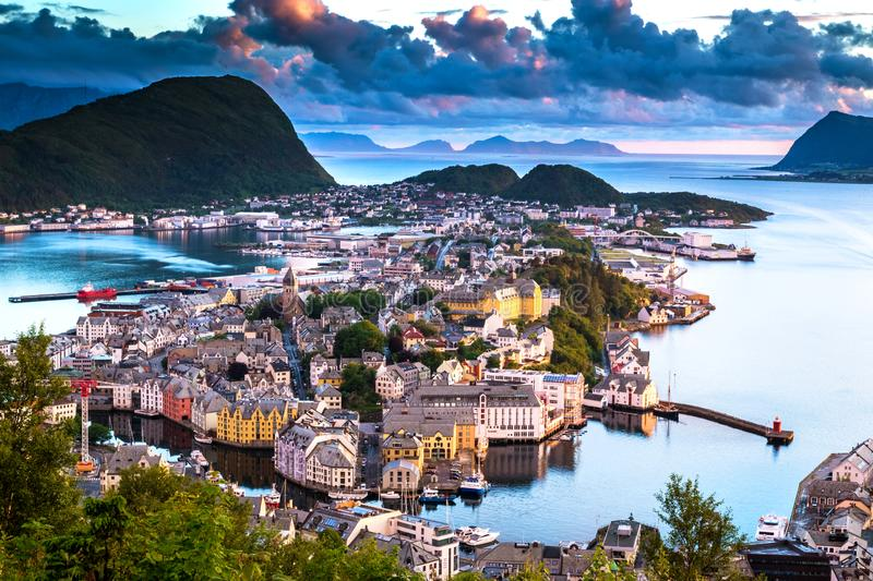 City Scene with Aerial View of Alesund Center after Sunset. Image of Alesund after sunset in Summer taken from Mount Aksla Viewpoint. Alesund is a port town on stock images