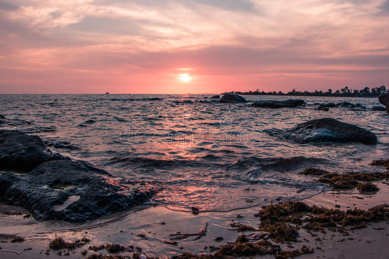 Colorful sunset on the coast of the Gulf of Thailand royalty free stock photography