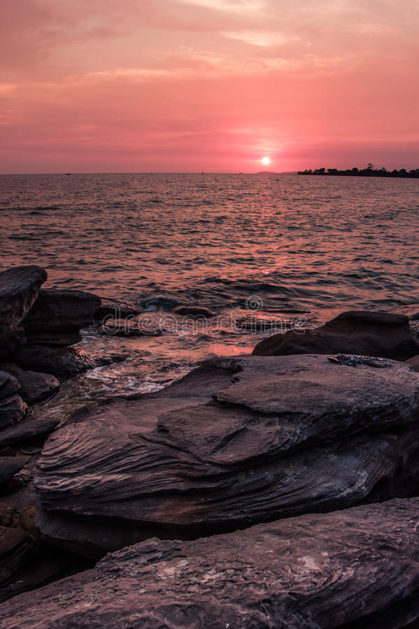 Colorful sunset on the coast of the Gulf of Thailand stock photography