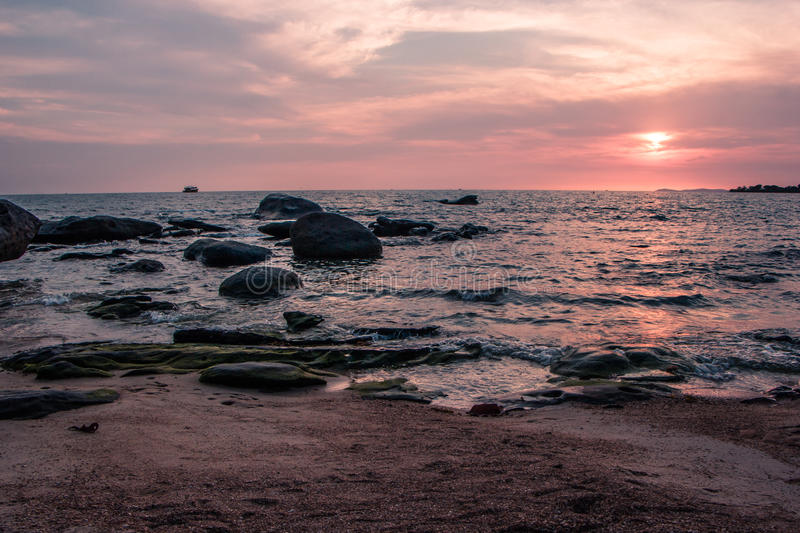Colorful sunset on the coast of the Gulf of Thailand royalty free stock image