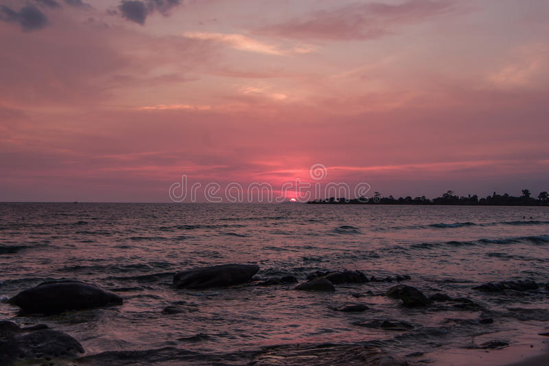 Colorful sunset on the coast of the Gulf of Thailand stock photos