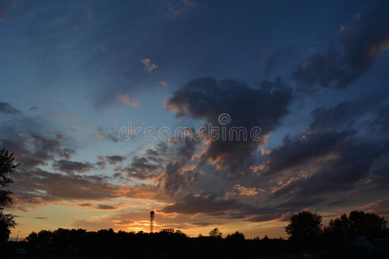 Colorful sunset with fluffy clouds in the sky stock photo