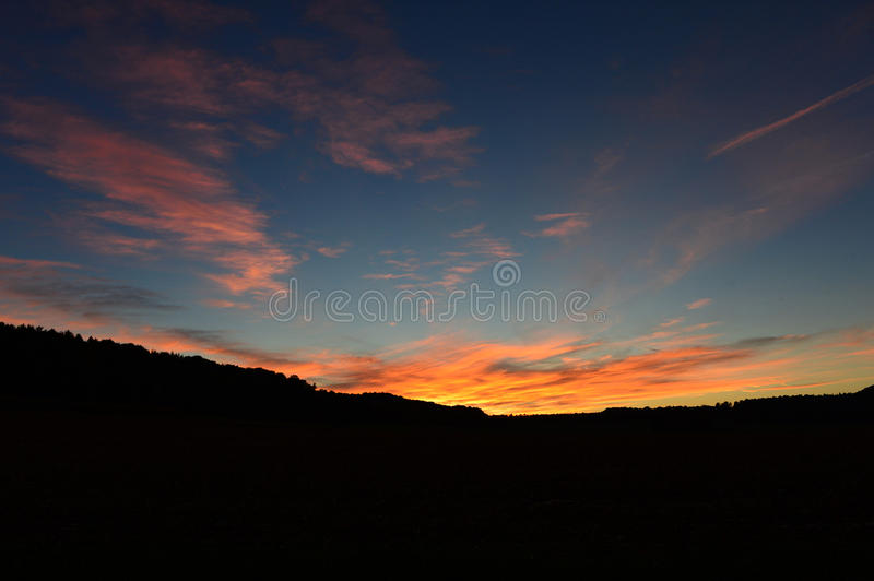 Colorful sunset over hills royalty free stock image