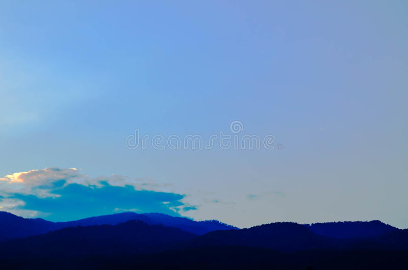 Colorful sunset over the mountain hills.  stock photo