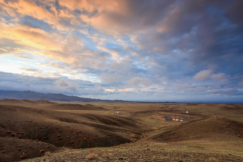 Colorful sunset over the mountains Gurvan Saikhan of southern Mo. Ngolia stock photo