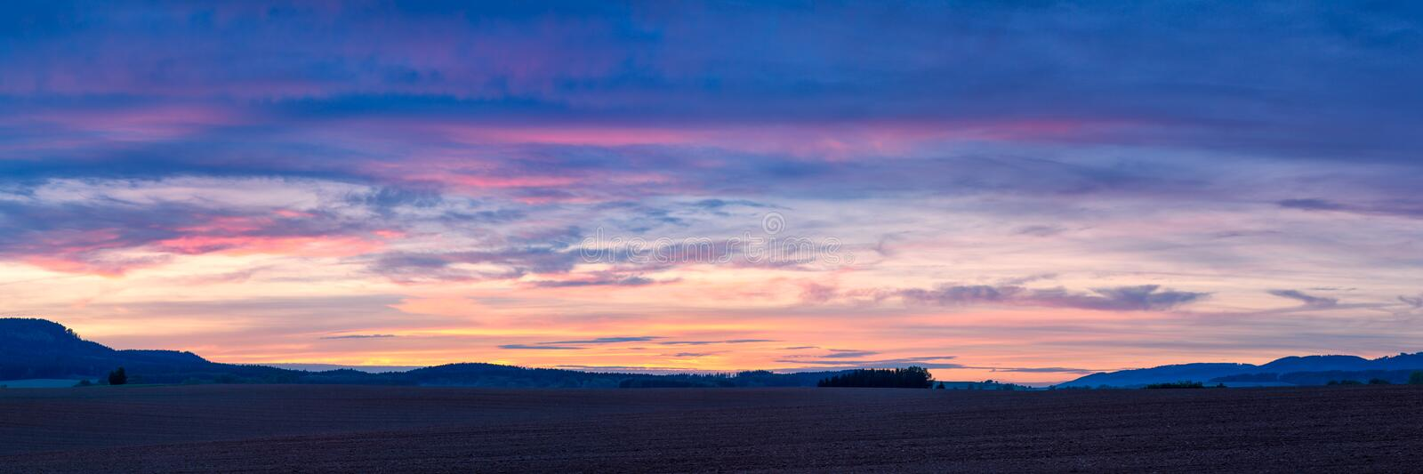 Colorful sunset over plowed fields in Northern Bohemia in the Czech Republic royalty free stock photography