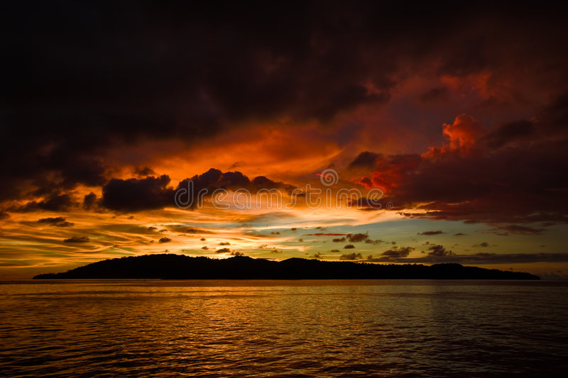Colorful sunset over rippled water stock photography