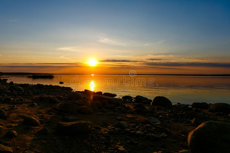 Colorful sunset over rippling lake surface, Belarus stock photography