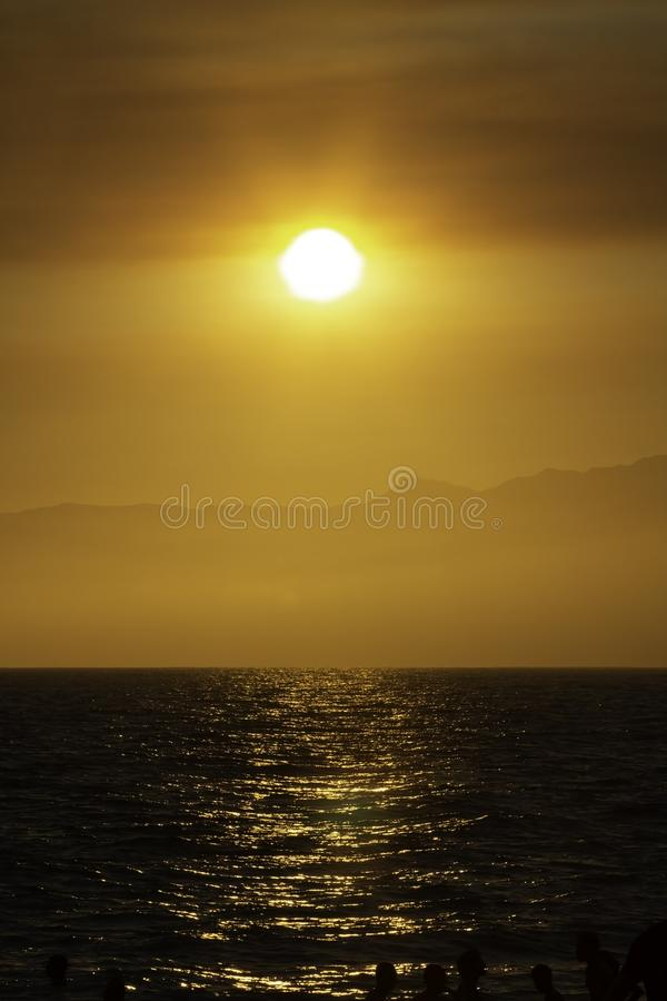 Colorful sunset over Santa Monica beach in California royalty free stock images