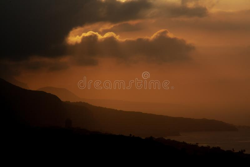 Colorful sunset over tenerife behind clouds stock photo