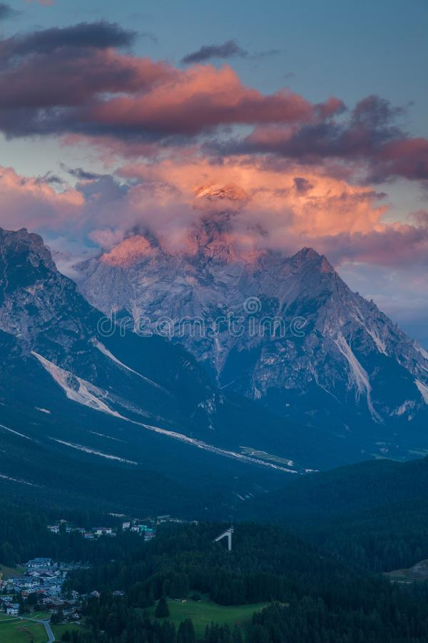 Colorful sunset over the town of Cortina d`Ampezzo stock photography