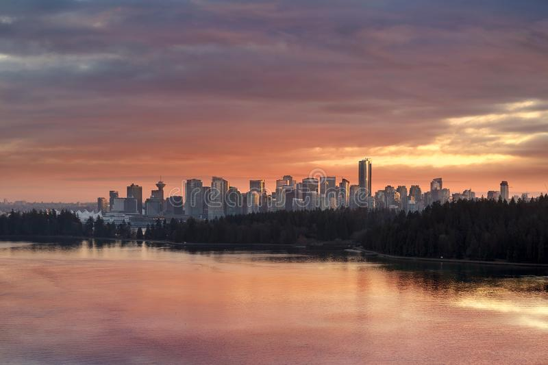Colorful Sunset over Vancouver BC Canada Downtown Skyline. Colorful dramatic sunset color sky over Stanley Park and downtown city Vancouver BC British Columbia stock photography