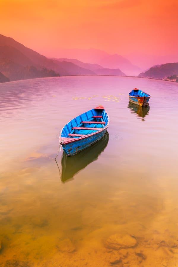 Colorful Sunset in Pewa Lake Pokhara Nepal stock photo