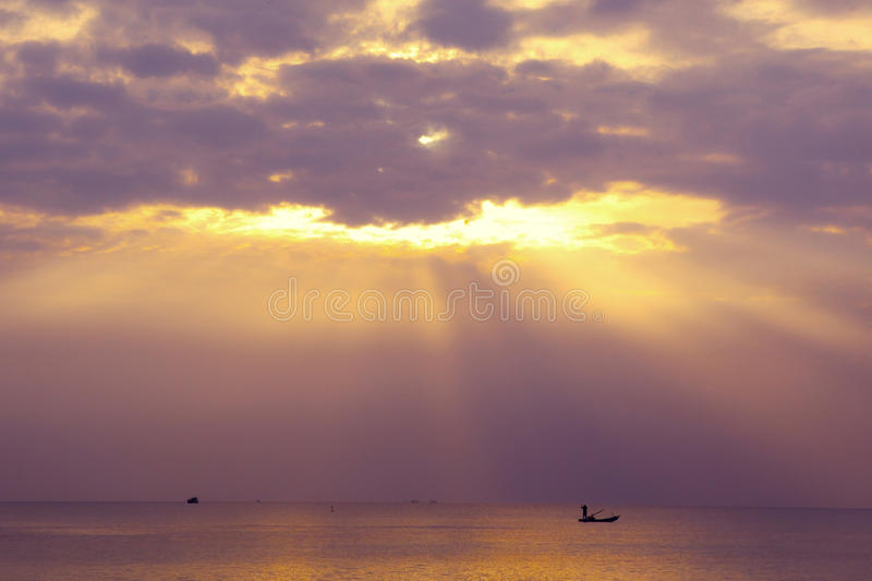 Colorful sunset on Phu Quock island Vietnam. Sun ray go through the cloud royalty free stock photo