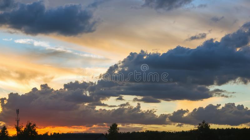 Colorful Sunset Sky With Dark Cumulus Clouds stock photography