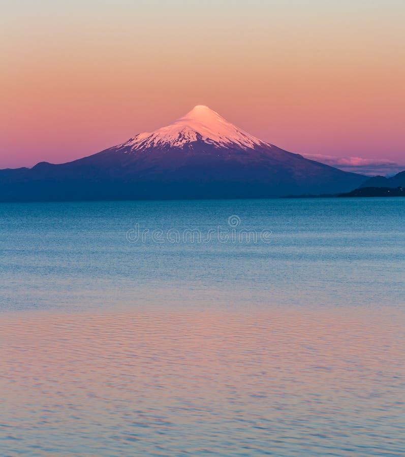Colorful sunset sky over Orsono Volcano in Puerto Vera, Chile. stock photo