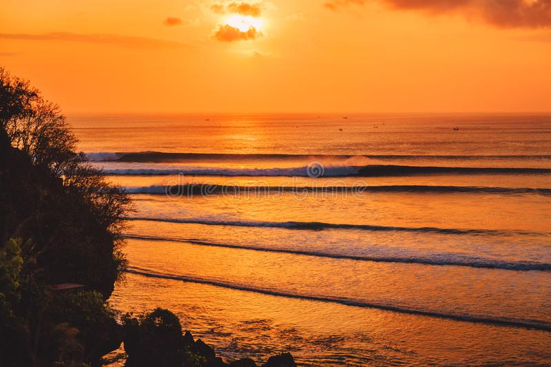 Colorful sunset or sunrise with ocean and big waves fo surfing stock photos