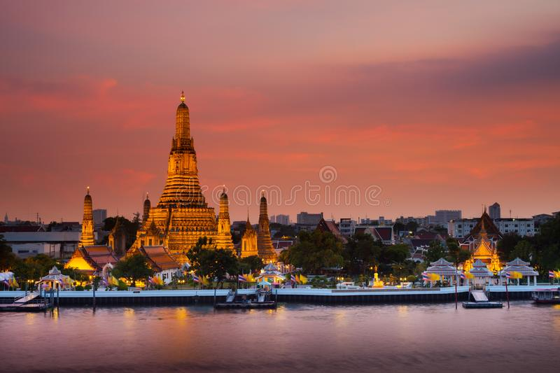 A colorful of sunset time reflection of gold pagoda `Wat Arun` royalty free stock photos