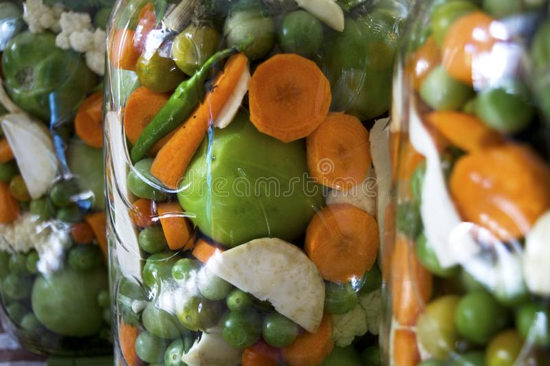 Pickled vegetables in big jars royalty free stock photography