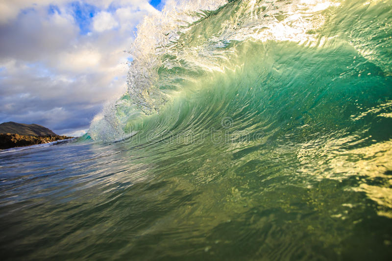 Colorful Surfing Wave Lit with sunlight in Oahu Hawaii USA stock photo
