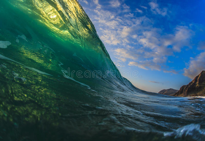 Colorful Surfing Wave Lit with sunlight in Pacific Ocean in Maui. Beautiful Ocean Background Big Shorebreak Wave for Surfing. Hawaiian swell for sport activity stock photos