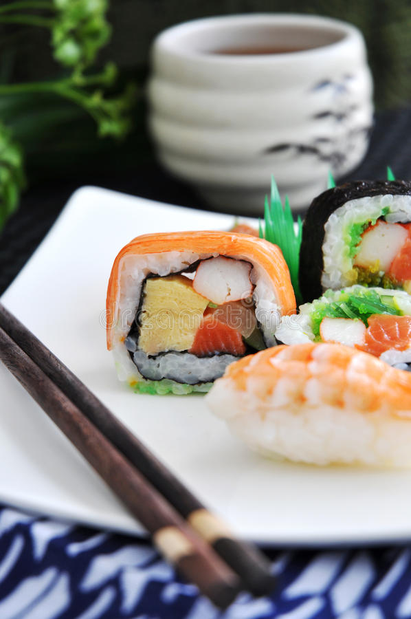 Colorful of sushi layer. With mixed sushi set on plate royalty free stock image