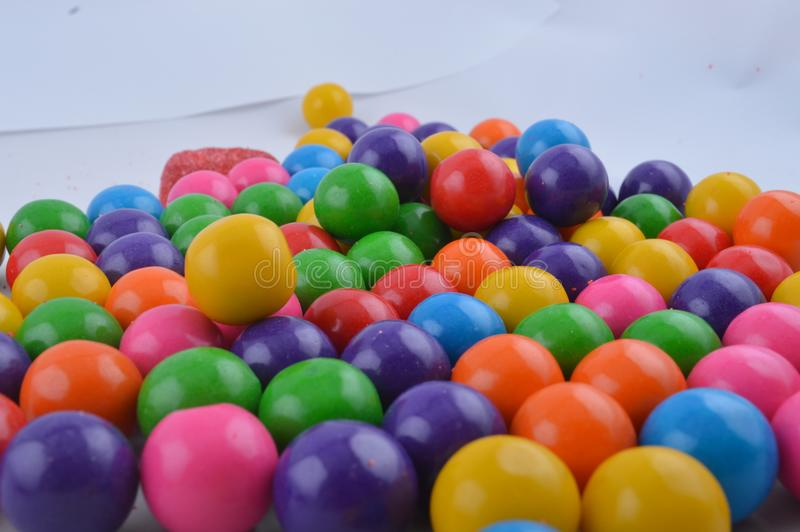 Colorful sweet gumballs thrown together stock image