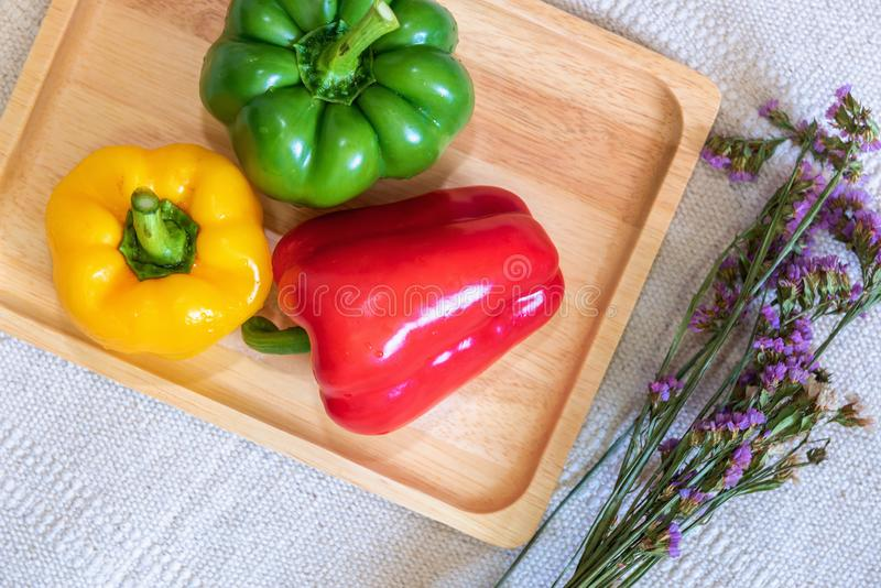 Colorful Sweet Peppers in a Wooden Tray, Raw Organic Vegetarian Food on a Table Ready to Cooking in The Kitchen Room. Chili Pepper. Ingredient Vegetables stock photography