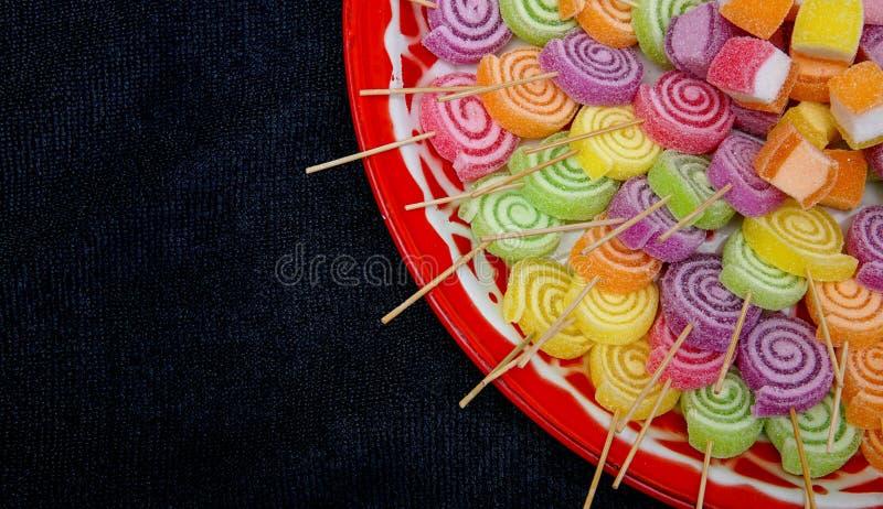 Colorful sweet sugar lolypop swirl roll stock photo