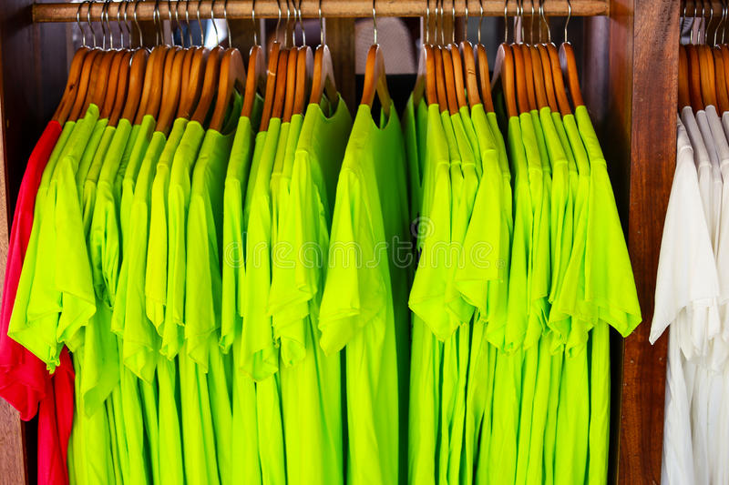 Colorful t-shirt with hangers royalty free stock images