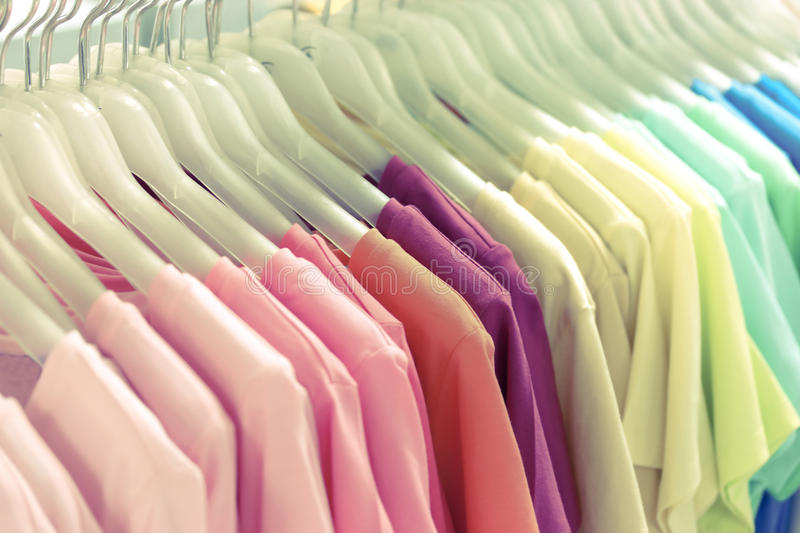 Colorful t-shirt on hangers royalty free stock photo