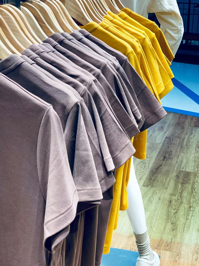 Colorful t-shirt on hangersfor sale in department stores royalty free stock image