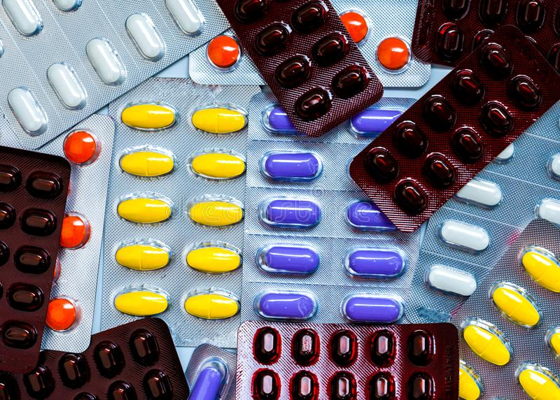Colorful tablet pills in blister packs. Global healthcare concept. Pain killers medicine use for relieve pain. Pile of colorful tablet pills in blister packs stock images