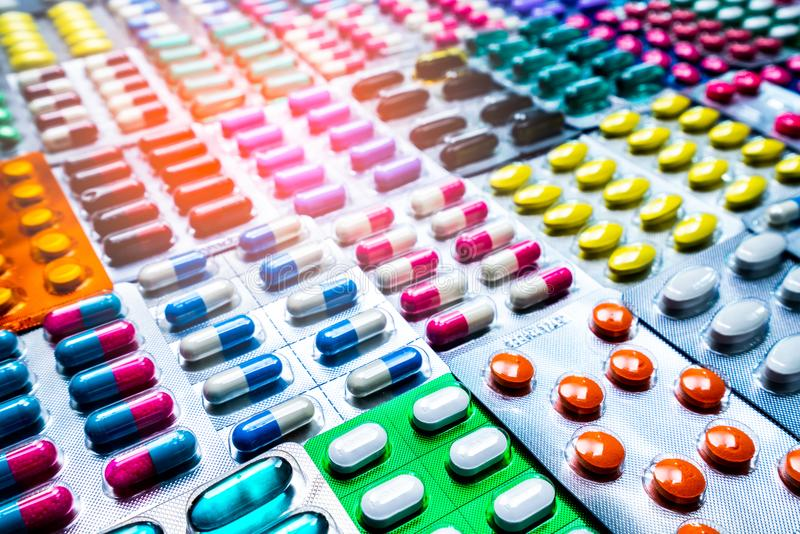 Colorful of tablets and capsules pill in blister packaging arranged with beautiful pattern. Pharmaceutical industry. Colorful of tablets and capsules pill in stock images